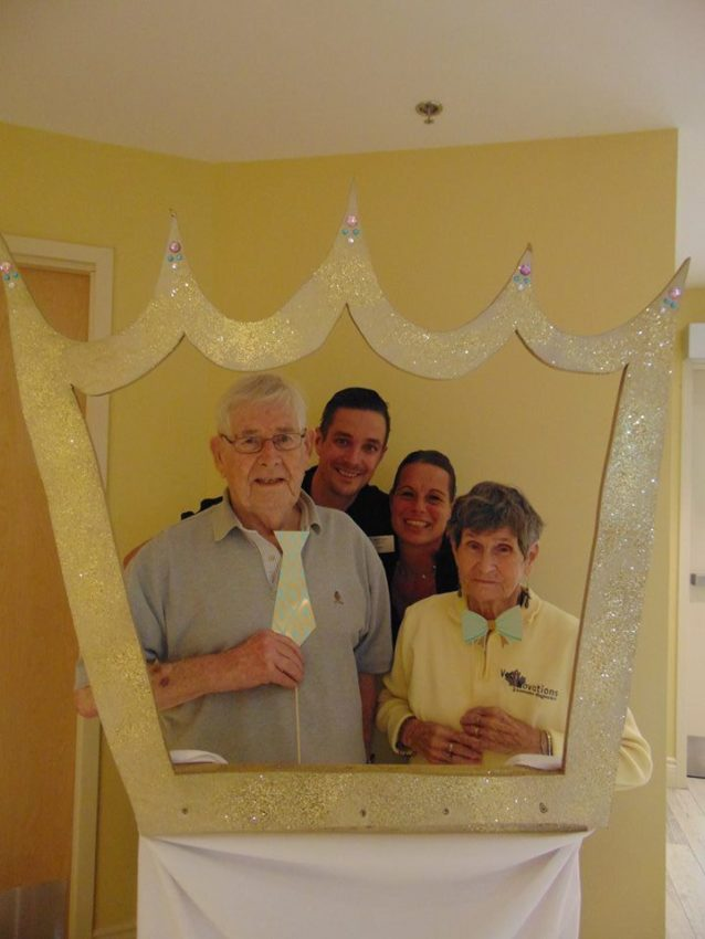 Orchard View by the Mississippi Sam & Margaret with our dining room staff posing in our crown photo booth